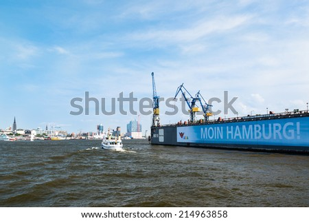 HAMBURG, GERMANY - JULY 21, 2014: The famous Blohm And Voss drydock number 10 with a banner stating Moin (local slang for Good Morning) Hamburg on July 21, 2014 in Hamburg, Germany.  - stock photo