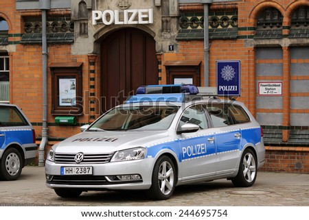 HAMBURG, GERMANY - JUNE 1, 2013: A German police car in front of the Hafencity police station featured in the German TV series 'Notruf Hafenkante' on June 1, 2013 in Hamburg.  - stock photo