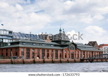 Hamburg, Germany - June 15th, 2013: look from the Elbe-river at the famous fish-auction-hall in Hamburg-Altona.