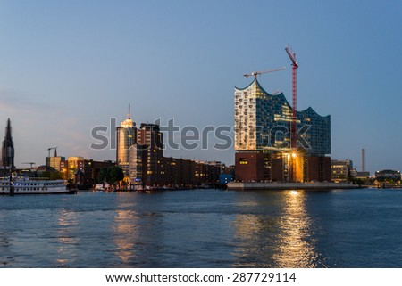 HAMBURG, GERMANY - JUNE 10. The Elbphilharmonie at night as main attraction in Hamburg on June 10, 2015. The building is deliberately designed Maritime. The forms are reminiscent of shipping and port - stock photo
