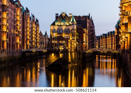 HAMBURG, GERMANY - JUNE 6, 2016: Typical view of the Speicherstadt, also called Hafen City,  in Hamburg on June 6, 2016. Its a popular harbour quarter for tourists in Hamburg.