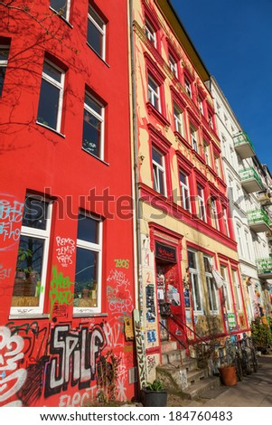 HAMBURG, GERMANY - MARCH 09: graffiti painted house in the Hafenstrasse on March 09, 2014 in Hamburg. The legendary street was known in the 80s when people from a protest movement squatted the houses.