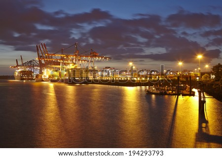 HAMBURG, GERMANY - MAY, 15. Container terminal Burchardkai in the deepwater port Hamburg-Waltershof taken in the evening of May 15, 2014.