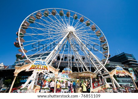 HAMBURG, GERMANY - MAY 7: Ferris wheel on the fair at the Hamburg Harbour Birthday Festival on May 7, 2011 in Hamburg, Germany.