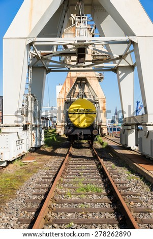 HAMBURG, GERMANY - MAY 06. Historical harbor cranes and railway carriage at the Port Museum at shed 50a in the harbor of Hamburg on May 06, 2015  - stock photo