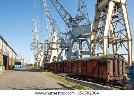 HAMBURG, GERMANY - MAY 06. Historical harbor cranes and railway carriage at the Port Museum at shed 50a in the harbor of Hamburg on May 06, 2015. The exhibit shows old harbor implement