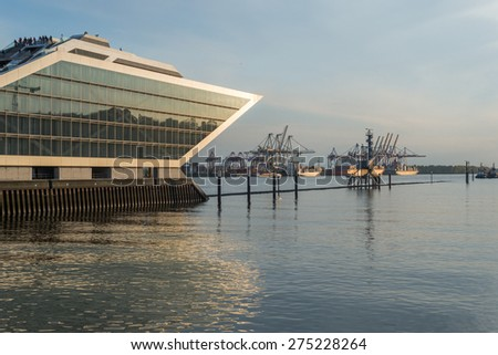 HAMBURG, GERMANY - MAY 04. The Dockland Hamburg Altona is the old fishing port in Hamburg on May 04, 2015. Now there are modern office buildings at the river Elbe. In the background the container port - stock photo