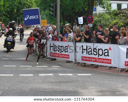 HAMBURG, GERMANY- MAY 22, 2011: Two african marathon runners at Hamburg Marathon on May 22, 2011 in Hamburg. It is one of the known and biggest marathons in Europe with about 15000 participants. - stock photo