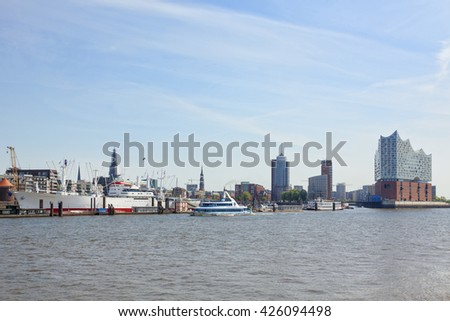 Hamburg, Germany - May 19, 2016: Waterfront from St pauli pier with museum ship Cap San Diego to HafenCity quarter with Elbe Philharmonic Hall, tourist boat on the Elbe river.