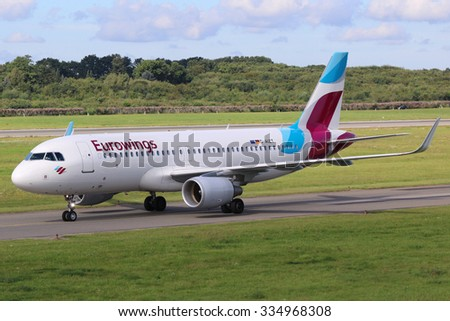 HAMBURG, GERMANY - SEPTEMBER 3:  A Eurowings Airbus A320 taxis on September 3, 2015 in Hamburg, Germany. Eurowings is a German airline. It is a subsidiary of Lufthansa. - stock photo