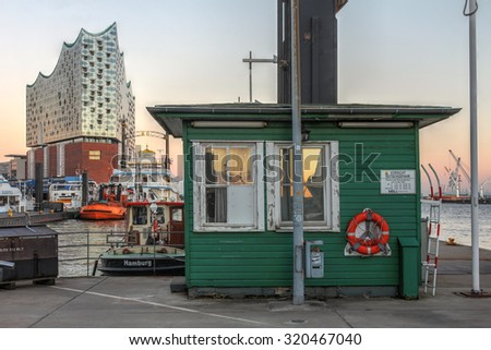 HAMBURG, GERMANY - SEPTEMBER 20: Scene in the Hamburg port along the river Elbe with still under construction landmark Elbe Philharmonic Hall in the background on Sept. 20, 2015 - stock photo