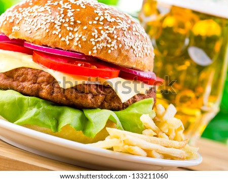 Hamburger and beer - stock photo