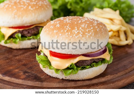 hamburger and vegetables on wooden table