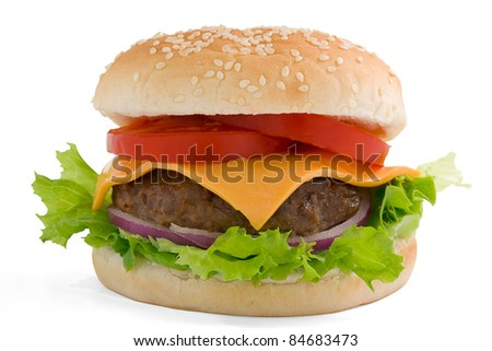 Hamburger, beef cheese tomato and red onion on a sesame bun. With clipping path.