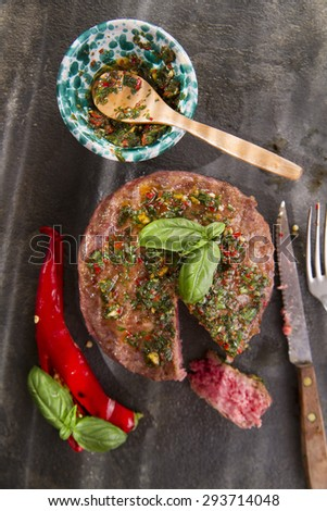 Hamburger beef with basil and hot pepper sauce - stock photo
