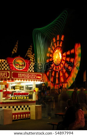 Hamburger booth as part of the midway at the 2009 Douglas County Fair in Roseburg Oregon at night. - stock photo