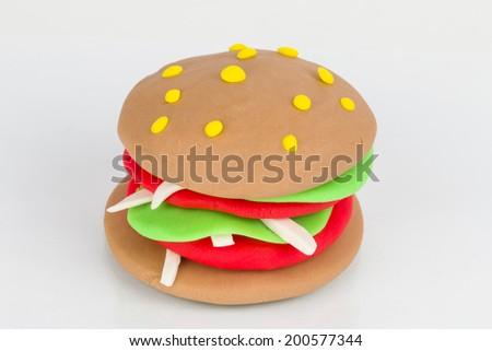 Hamburger from children bright plasticine - Stock Image macro. - stock photo