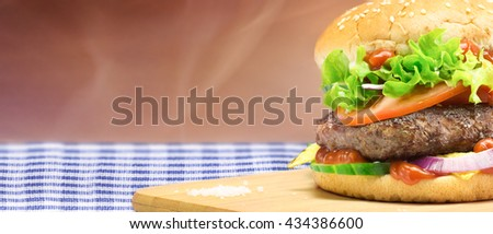Hamburger, homemade, authentic burger with fresh vegetables - horizontal copy space layout
