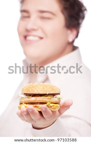 hamburger in hand of a young chubby man, isolated on white