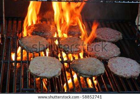 Hamburger meat on grill - stock photo