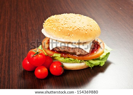 hamburger on a wood table