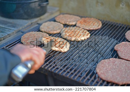 Hamburger on barbecue. - stock photo