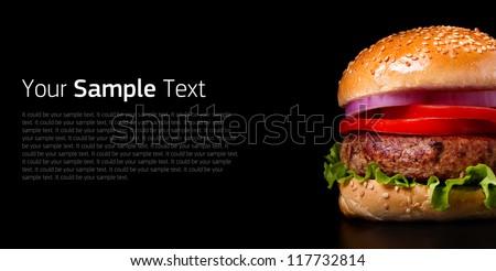 Hamburger on black background - stock photo