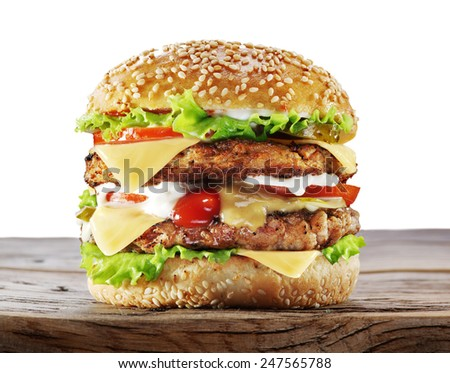 Hamburger on old wooden table. File contains clipping paths.