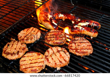 Hamburger patties on grill - stock photo