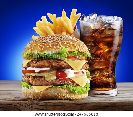 Hamburger, potato fries, cola drink. Takeaway food. - stock photo