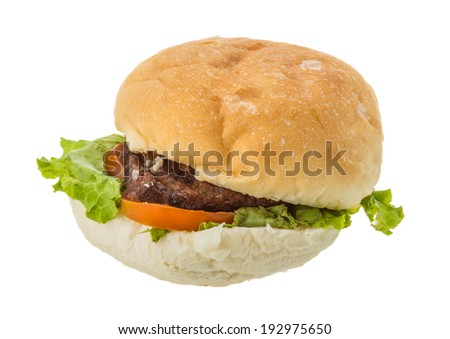 Hamburger with beef, salad and tomato - stock photo