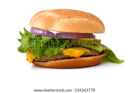 Hamburger with cheese, meat and fresh vegetables