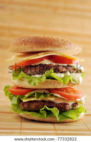 hamburger with cutlet and vegetables on bamboo napkin