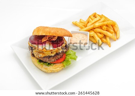 Hamburger with french fries om white plate - stock photo