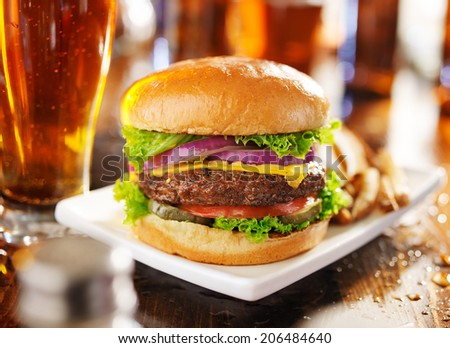 hamburger with fries and beer shot in panorama style