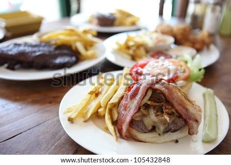hamburger with fries and salad - stock photo