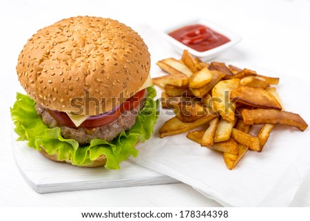 Hamburger with fries and sauce - stock photo