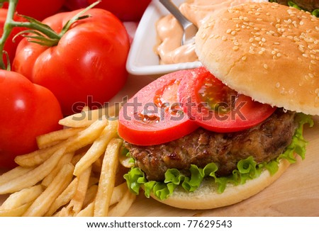 hamburger with fries and vegetables - stock photo