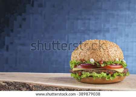 Hamburger with lager beer on red background. Closeup. American style - stock photo