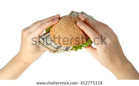Hamburger with money in hand on white background. - stock photo