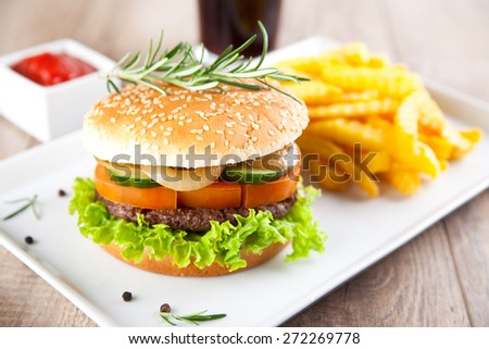 Hamburger with potato chips and drink - stock photo