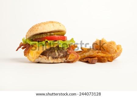 Hamburger with sweet potato wedges - stock photo