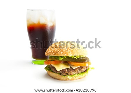hamburger with tomato,lettuce,meat,cheese,onion with black drink over white background
