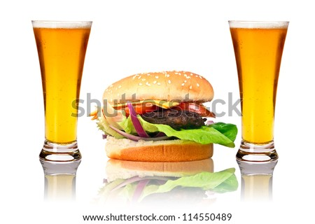 Hamburger with two beers over white