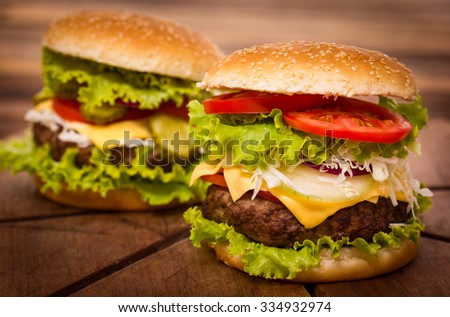 Hamburgers on the wooden table closeup