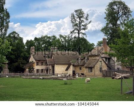 Hameau de la reine, Village of the Queen, rustic village at Trianon, Versailles, for Marie Antoinette - stock photo