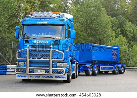 HAMEENLINNA, FINLAND - JULY 16, 2016: Blue Scania 164G V8 truck and gravel trailers for construction of Haanpaan Kuljetus Oy on the annual Tawastia Truck Weekend 2016. Public event. - stock photo