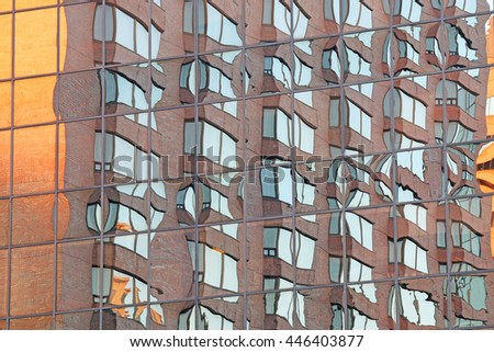 HAMILTON, CANADA - JULY 2, 2016: Close-up of the glass facades of Hamilton high-rise buildings. This Canadian port city is on the western tip of Lake Ontario and centre of a densely populated region