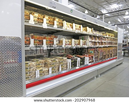 HAMILTON, CANADA - JULY 4, 2014: Meat corridor in Costco Wholesale store  Hamilton Ontario, Canada.  Costco operates a chain of membership warehouses, carrying merchandise at lower prices.  - stock photo