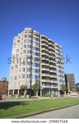 HAMILTON, ONTARIO, - JULY 19, 2015:  Apartment block, Hamilton, Ontario, Canada. Hamilton is the centre of a densely populated and industrialized region at the west end of Lake Ontario  - stock photo